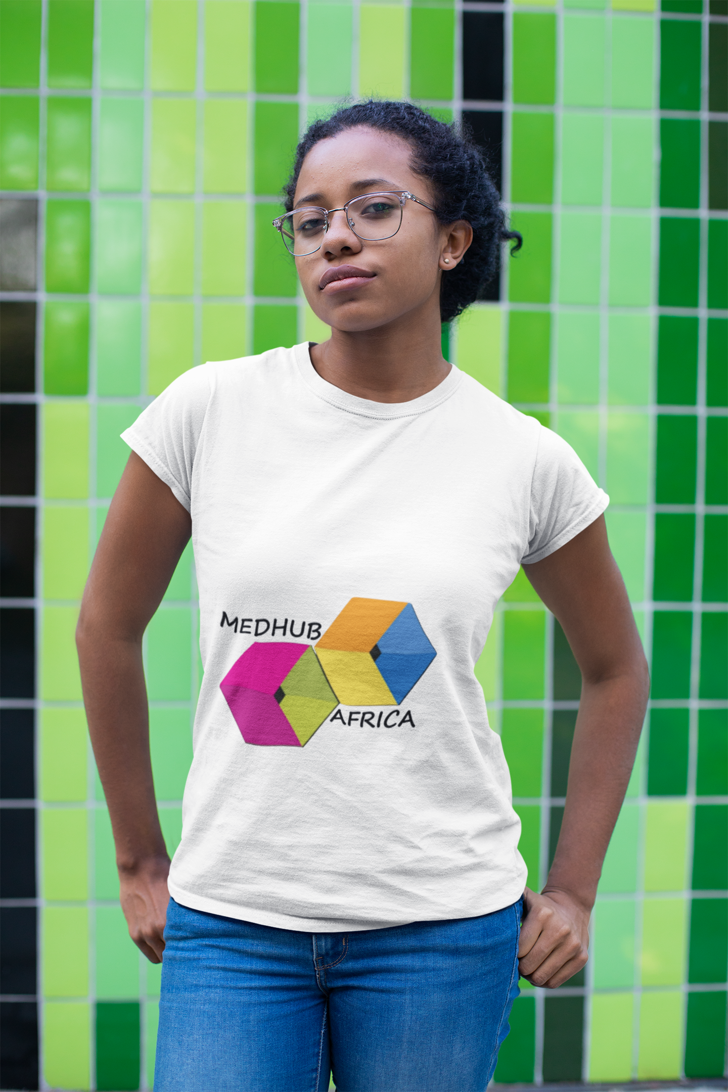 t-shirt-mockup-of-a-girl-with-glasses-standing-in-front-of-a-green-mosaic-24100 (1)